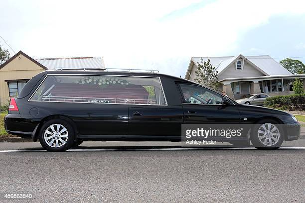 The hearse carrying Phillip Hughes departs the Funeral Service for Phillip Hughes on December 3 2014 in Macksville Australia Australian cricketer...