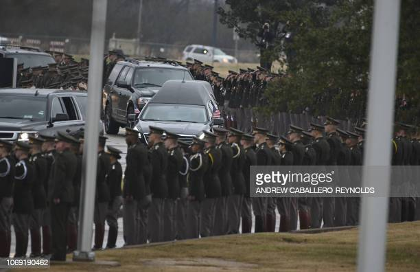 The hearse carrying the body arrives for the interment ceremony of former US President George HW Bush at the George HW Bush Presidential Library and...