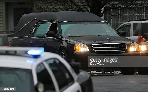 The hearse carrying the body of 6yearold Jack Pinto departs Honan Funeral Home following his funeral on December 17 2012 in Newtown Connecticut Pinto...