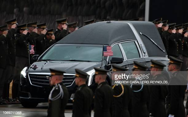 The hearse carrying the body of former US President George HW Bush arrives for the interment ceremony at the George HW Bush Presidential Library and...