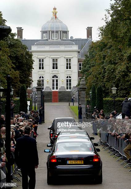 The hearse carrying the body of Prince Claus of the Netherlands husband to Dutch Queen Beatrix arrives with close relatives at royal Palace 'Huis ten...
