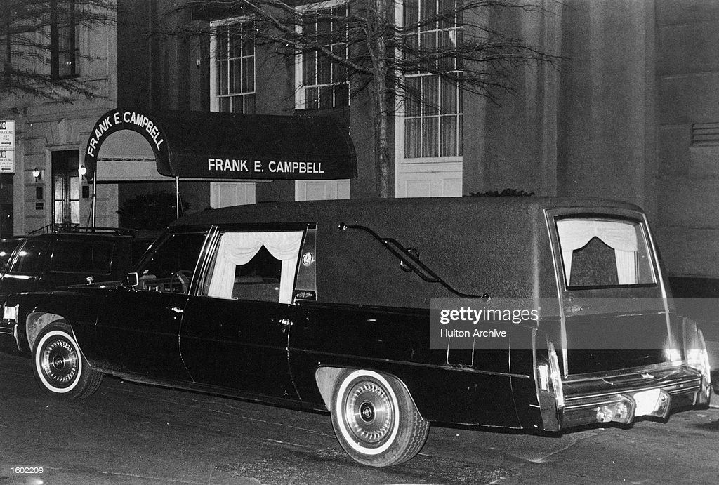 The hearse carrying the body of slain British musician John Lennon parked outside the Frank E. Campbell funeral home, New York City, December 1980 (Photo by Hulton Archive/Getty Images).