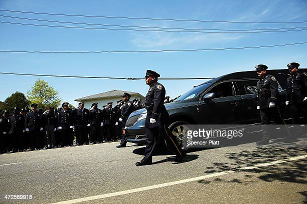 The hearse carrying the casket for fallen New York City police officer Brian Moore leaves a Long Island church on May 8 2015 in Seaford New York...