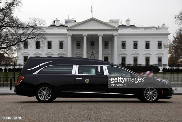 The hearse carrying the casket of former President George HW Bush drives past the White House in Washington DC US on Wednesday Dec 5 2018 Bush the...