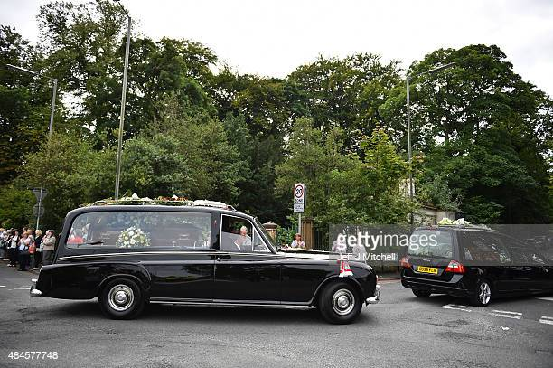 The hearse carrying the coffin of Cilla Black leaves St Mary's RC Church in Woolton after her funeral on August 20 2015 in Liverpool England Singer...
