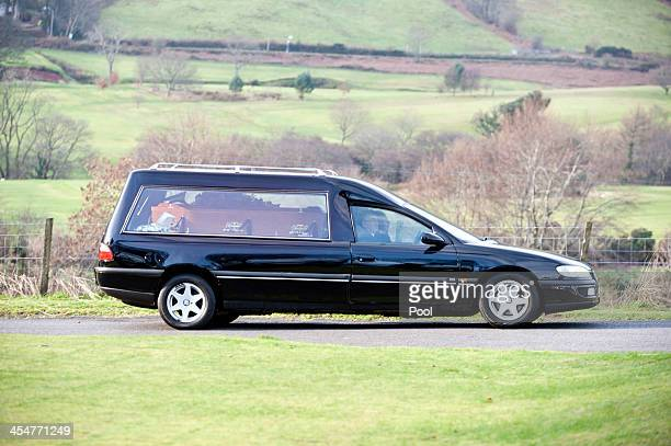 The hearse carrying the coffin of Clutha Vaults victim Constable Tony Collins arrives for his funeral at Lamlash cemetery on December 10 2013 in...
