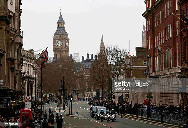 The hearse carrying the coffin of former British Prime Minister Baroness Margaret Thatcher travels along Whitehall on its way to her funeral service...