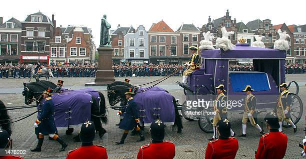The hearse carrying the coffin of Prince Claus of the Netherlands is drawn towards the Nieuwe Kerk church on its way to the funeral ceremony October...