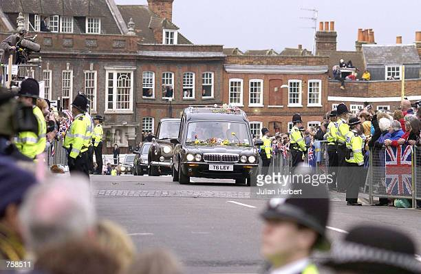The hearse carrying the coffin of the Queen Mother arrives at Windsor Castle after her funeral service in London April 9 2002 in Windsor