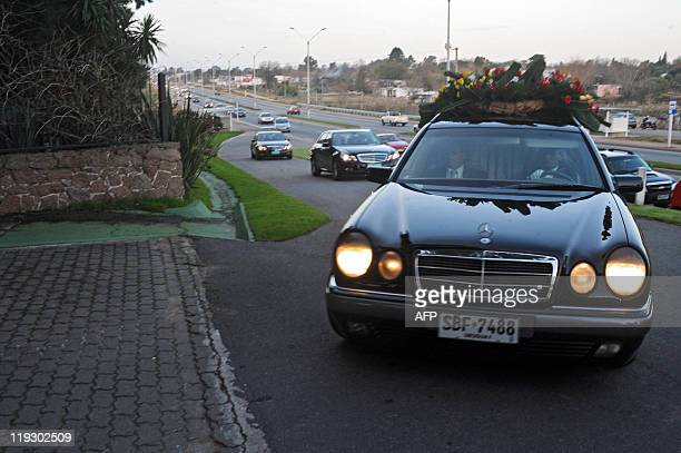 The hearse carrying the remains of former Uruguayan dictator Juan Maria Bordaberry arrives for the burial to a private cemetery near Colonia Nicolich...
