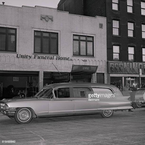 The hearse containing the body of Malcolm X pulls up in front of the Unity Funeral Home here where a wake for him will be held The body of the 39...