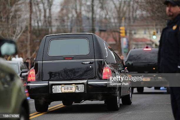 The hearse leaves the funeral services for six yearold Noah Pozner who was killed in the shooting massacre in Newtown CT at Abraham L Green and Son...