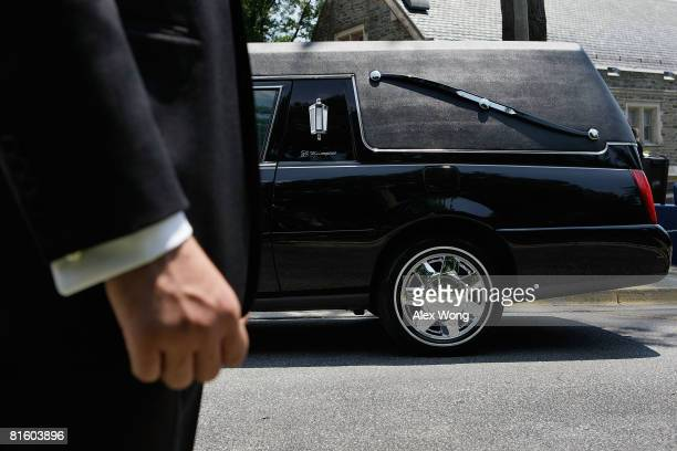The hearse of late moderator of Meet the Press Tim Russert parks at St. Albans School June 17, 2008 in Washington, DC. A public viewing was held at...