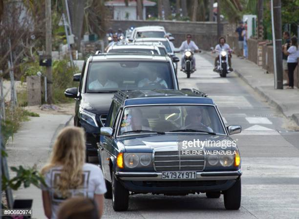 The hearse with the remains of French rock icon Johnny Hallyday leads the procession to the Lorient Cemetery in Saint Barthélemy on December 11 2017...