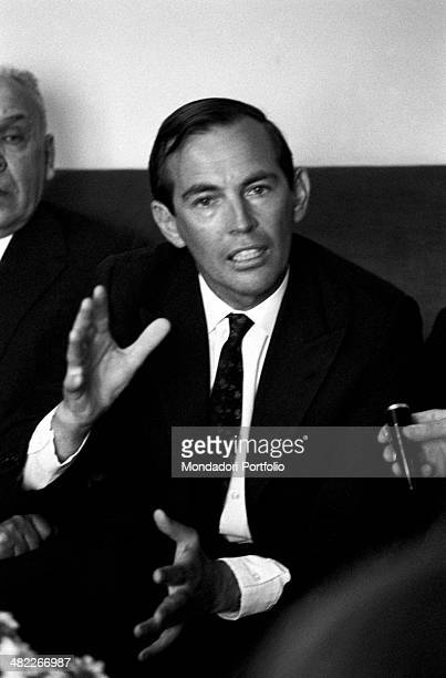 The heart surgeon Christiaan Barnard sitting on a sofa next to him one can glimpse the Russian scientist and father of resuscitation Vladimir...
