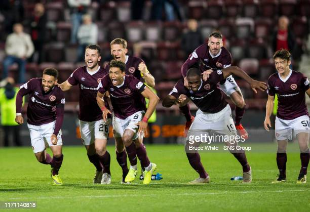 The Hearts players celebrate after winning the penalty shootout during the Betfred Cup Quarter-Final match between Heart of Midlothian and Aberdeen...
