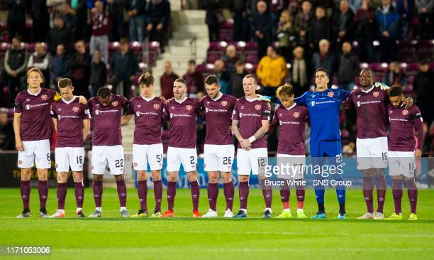 The Hearts players observe a minutes silence ahead of the Betfred Cup Quarter-Final match between Heart of Midlothian and Aberdeen at Tynecastle Park...