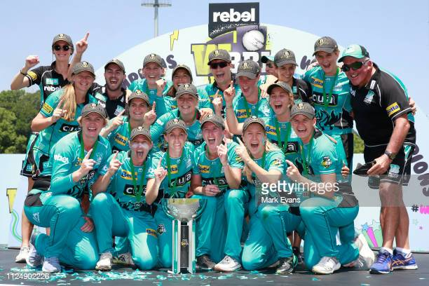 The Heat celebrate their win during the Women's Big Bash League Final between the Sydney Sixers and the Brisbane Heat at Drummoyne Oval on January 26...