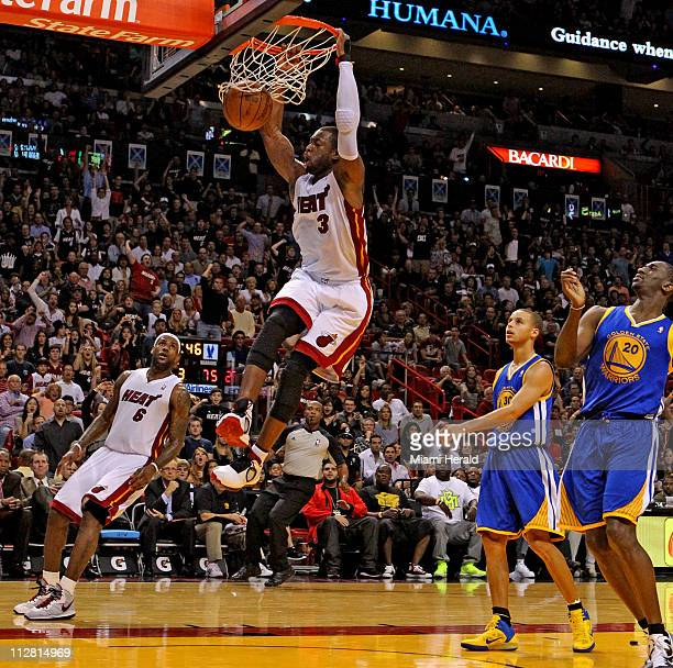 The Heat's Dwyane Wade dunks the ball against the Golden State Warriors during the third quarter at the American Airlines Arena in Miami Florida...