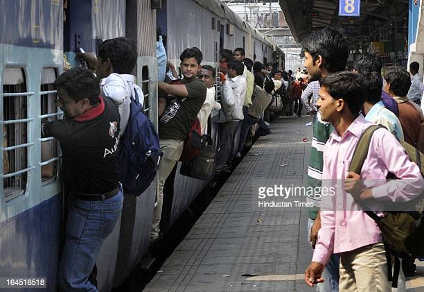 The heavy rush of train passengers due to Holi festival at New Delhi Railway Station on March 24 2013 in New Delhi India Holi the Hindu festival of...