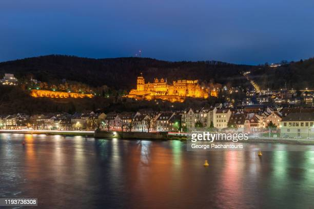 the heidelberg castle at dusk - heidelberg stock-fotos und bilder