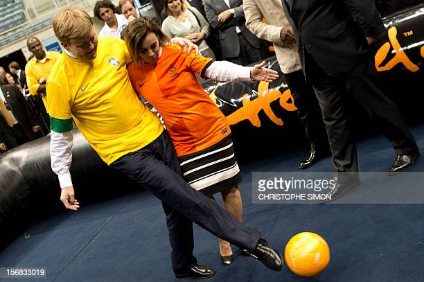 The heir to the Dutch throne WillemAlexander and Rio de Janeiro's Sports Secretary Marcia Lins play Panna KnockOut during the presentation of this...