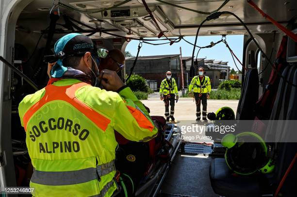 The Helicopter emergency medical personnel are preparing to take off on June 28, 2020 in Turin, Italy. The HEMS helicopter rescue service was...