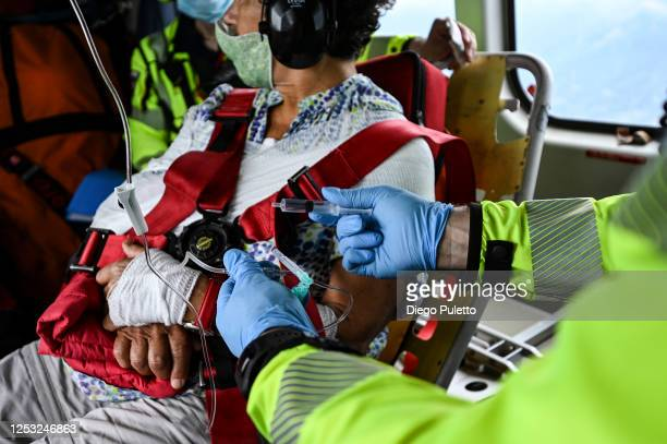 The Helicopter emergency medical personnel assist a patient during a rescue operation on June 28, 2020 in Turin, Italy. The HEMS helicopter rescue...