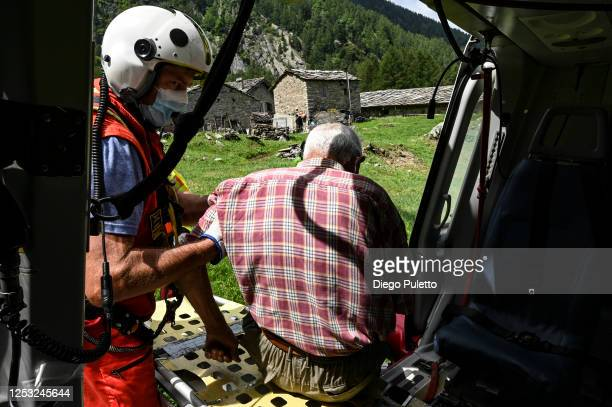 The Helicopter emergency medical personnel assist a patient to board during a rescue operation on June 28, 2020 in Turin, Italy. The HEMS helicopter...