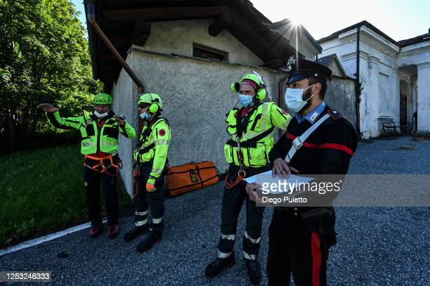 The Helicopter emergency medical personnel carry out a briefing with the police during a search and rescue operation in the Alpine region on June 28,...