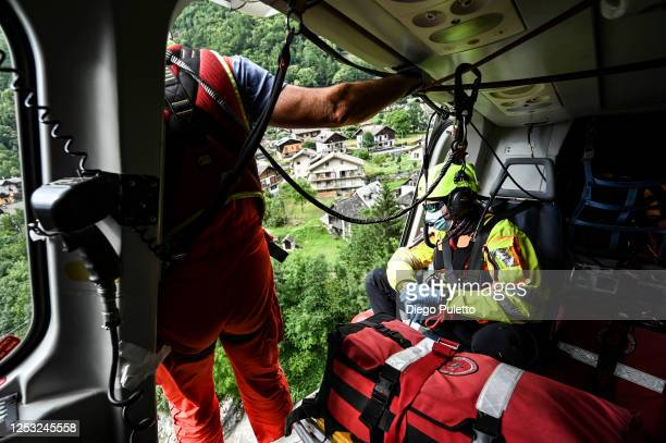 The Helicopter emergency medical personnel check that the landing gear is free during a rescue operation on June 28, 2020 in Turin, Italy. The HEMS...