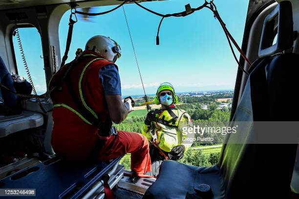 The Helicopter emergency medical personnel during a Helicopter Hoist Operation in the Alpine region on June 28, 2020 in Turin, Italy. The HEMS...