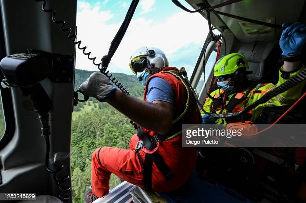 The Helicopter emergency medical personnel during a search and rescue operation on June 28, 2020 in Turin, Italy. The HEMS helicopter rescue service...