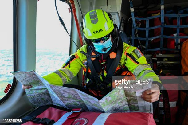 The Helicopter emergency medical personnel look at the map during a Rescue operation in the Alpine region on June 28, 2020 in Turin, Italy. The HEMS...
