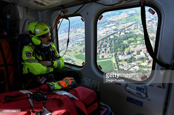 The Helicopter emergency medical personnel look out the window during a search and rescue operation in the Alpine region on June 28, 2020 in Turin,...
