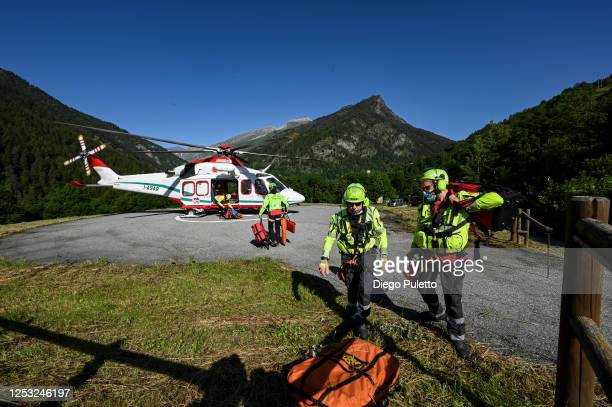 The Helicopter emergency medical personnel prepare to take off during a search and rescue operation in the Alpine region on June 28, 2020 in Turin,...