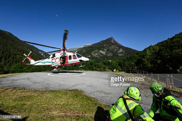 The Helicopter emergency medical personnel take off during a search and rescue operation in the Alpine region on June 28, 2020 in Turin, Italy. The...