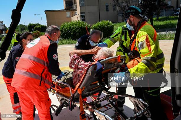 The Helicopter emergency medical personnel transport a patient on a stretcher to the hospital on June 28, 2020 in Turin, Italy. The HEMS helicopter...