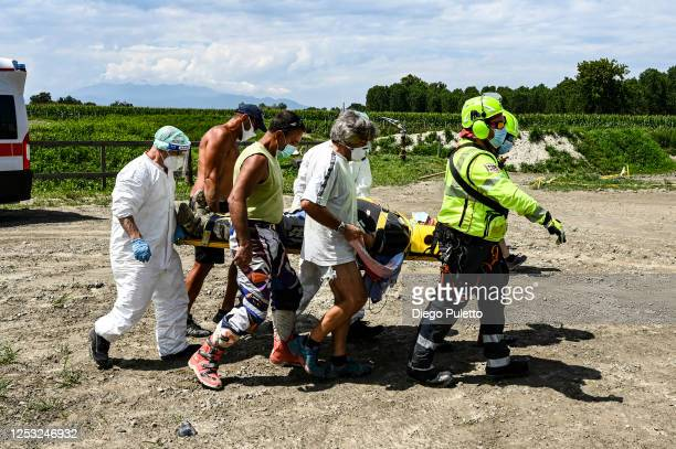 The Helicopter emergency medical personnel transport the patient to the stretcher during a rescue operation on June 28, 2020 in Turin, Italy. The...