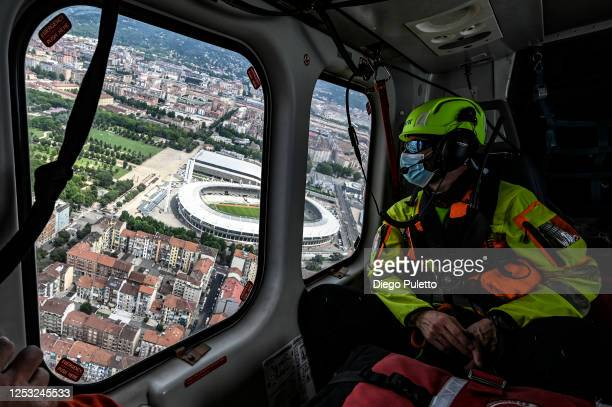 The Helicopter emergency medical personnel watch the Grande Torino Olympic Stadium during a rescue operation on June 28, 2020 in Turin, Italy. The...
