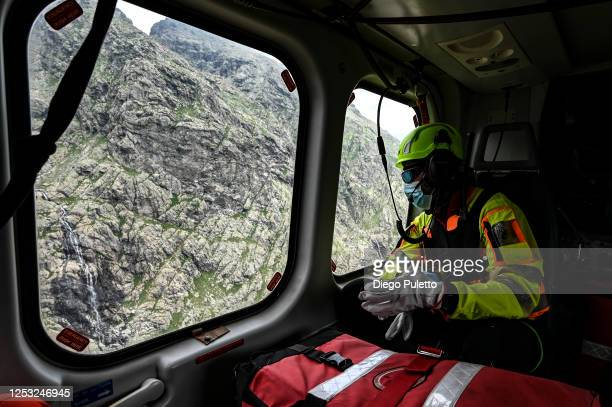 The Helicopter emergency medical personnel watch the window mountains during a rescue operation in the Alpine region on June 28, 2020 in Turin,...