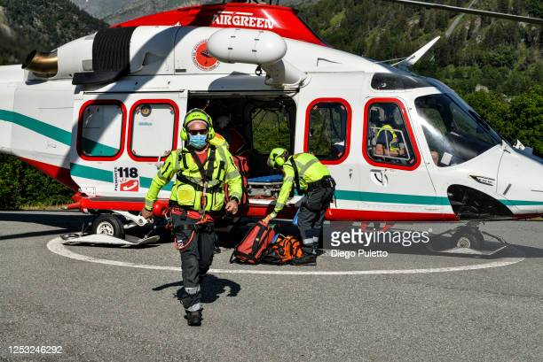 The Helicopter emergency medical service personnel land during a Search and Rescue operation in the Alpine region on June 28, 2020 in Turin, Italy....