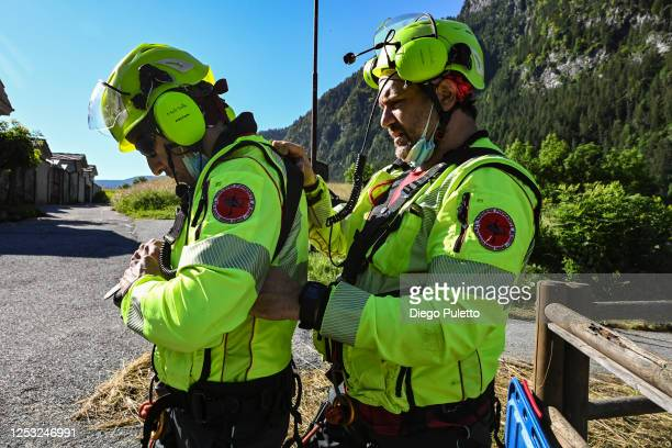 The Helicopter emergency medical staff checks the harness during a search and rescue operation in the Alpine region on June 28, 2020 in Turin, Italy....