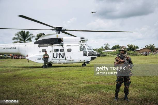The helicopter of the United Nations secretary-general lands prior to a visit to an Ebola treatment centre in Mangina, North Kivu province, on...