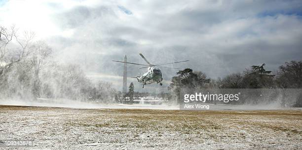 The helicopter that will serve as Marine One blows up snow as it lands on the South Lawn of the White House prior to the departure of President...