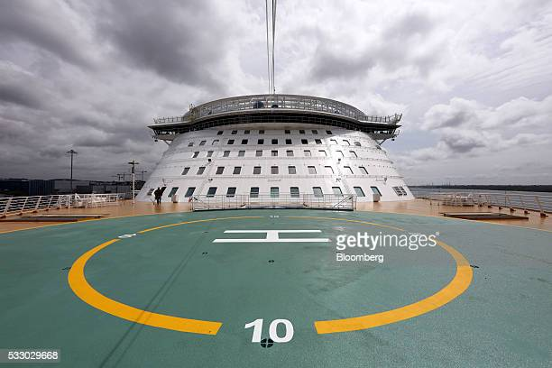 The helipad stands at the bow of the Royal Caribbean Cruise Ltd's Harmony of the Seas Oasisclass cruise ship docked in Southampton UK on Friday May...