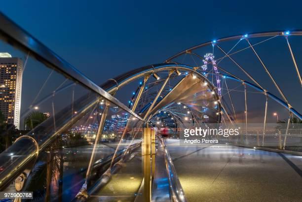 the helix bridge, marina bay, singapore - marina bay singapore stock pictures, royalty-free photos & images