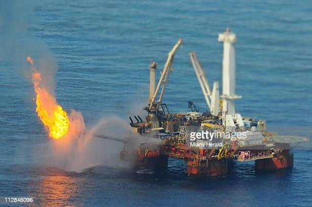 The Helix Q 4000 burns off excess methane gas near the site of the Deepwater Horizon incident in the Gulf of Mexico on Sunday July 4 2010