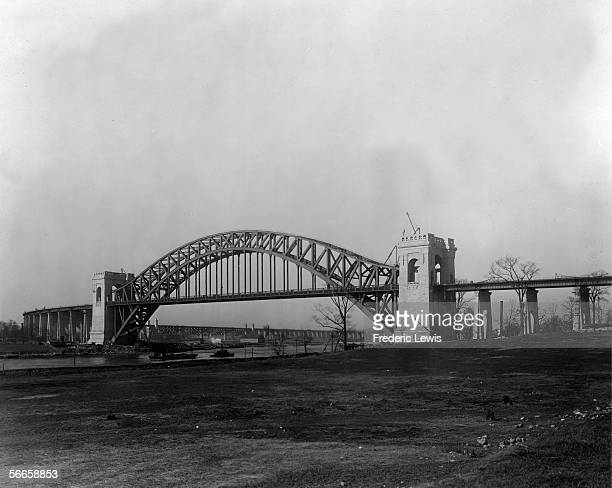 The Hell Gate Bridge over a part of the East River called Hell Gate which separates Astoria Queens from Ward's Island during construction mid 1910s...