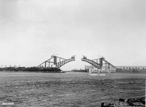 The Hell Gate Bridge over a part of the East River called Hell Gate which separates Astoria Queens from Ward's Island is seen under construction New...